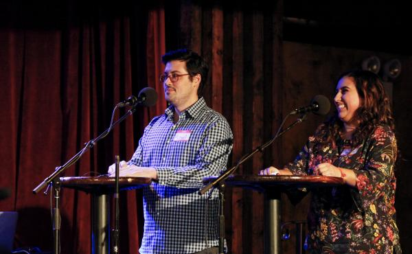 Contestants Michael Serafino and Ciera Velarde play a game on the Ask Me Another stage at the Bell House in Brooklyn, New York.