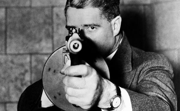 The 1936 film You Can't Get Away With It about the FBI portrays a typical G-man of the era, complete with machine gun.