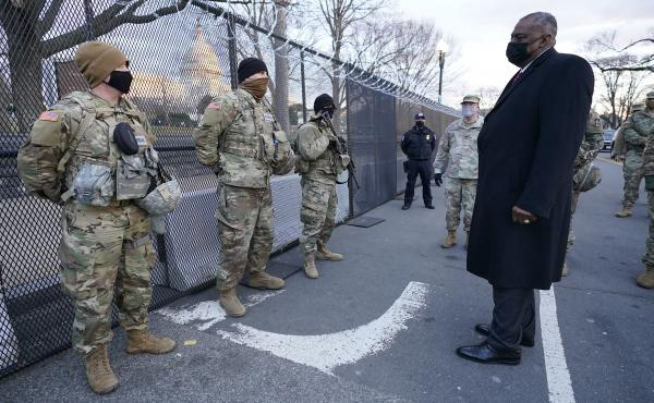 """Defense Secretary Lloyd Austin visits National Guard troops deployed at the U.S. Capitol on Jan. 29. The troops were deployed in the wake of the Jan. 6 Capitol attack. Under Austin's order, all military units are holding """"stand downs"""" to discuss extremism"""