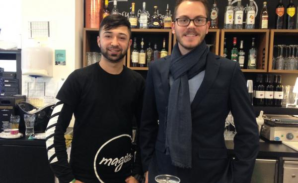 Sebastiaan De Vos, right, the general manager of Vienna's Magdas Hotel, recruits refugees like 24-year-old Ehsan Amini, left, to work at the hotel. Amini, who works in the Magdas cafe, fled Afghanistan and arrived in Austria five years ago. He's one of 20