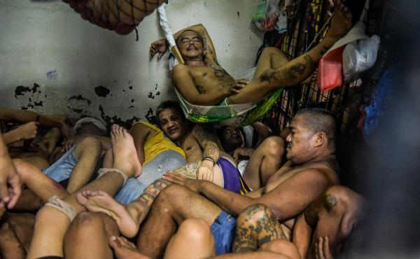 Prisoners sleep inside one of the overcrowded jails in the Tondo district in Manila, Philippines. More than 700,000 suspected narcotics users and dealers have been arrested or turned themselves in since President Rodrigo Duterte announced his war on drugs