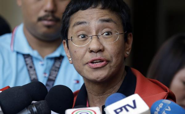 Journalist Maria Ressa talks to reporters on March 29, 2019, after posting bail at a trial court in Metro Manila, Philippines. This Friday, the 2021 Nobel Peace Prize was awarded to Ressa and journalist Dmitry Muratov for the fight for freedom of expressi