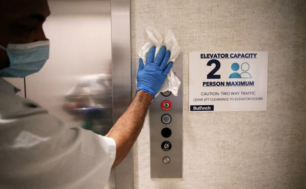 Elevator safety measures that take COVID-19 into account are posted at Cambridge Discovery Park, a life sciences office development in Cambridge, Mass.