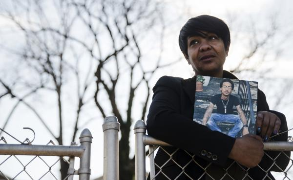 On Dec. 21, 2017, Trina Singleton holds a photo of her eldest son Darryl who was murdered in 2016. The Philadelphia Obituary Project, a new website, is working to show that homicide victims in Philadelphia are more than statistics.
