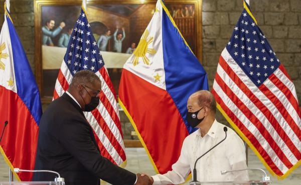 U.S. Defense Secretary Lloyd Austin, left, and Philippines Defense Secretary Delfin Lorenzana shake hands after a bilateral meeting at Camp Aguinaldo military camp in Quezon City, Metro Manila, Philippines Friday, July 30. Austin is visiting Manila to hol