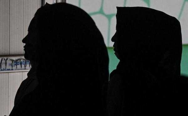 Afghan women gather to protest claims of human rights violations of women by the Taliban regime.