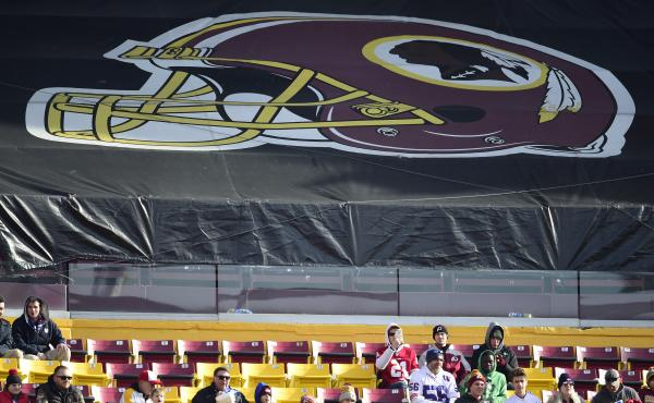 Fans sit in the stands before the start of a game between the New York Giants and Washington Redskins at FedEx Field in 2019 in Landover, Md. The Redskins, and other teams, are reviewing their names.