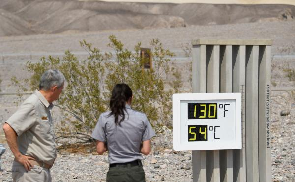 Visitors feel the heat in California's Death Valley earlier this week. This record-setting heat wave's remarkable power, reach and unusually early appearance is giving meteorologists yet more cause for concern about extreme weather in an era of climate ch