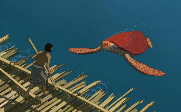 A castaway meets his reptilian — adversary? — in The Red Turtle.