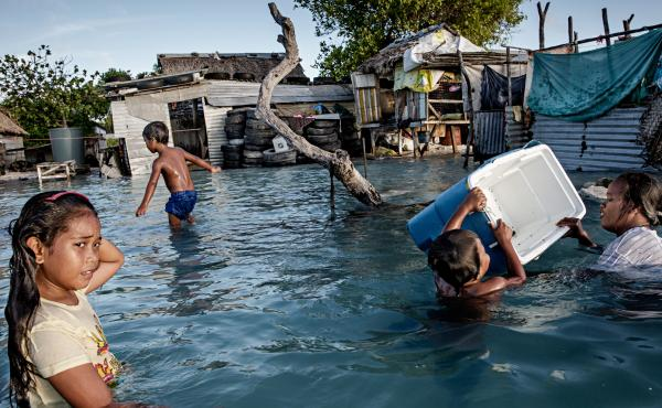 In Kiribati, an island republic in the Central Pacific, large parts of the village Eita (above) have succumbed to flooding from the sea.