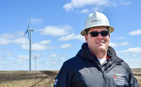 Jayme Orrack oversees Xcel Energy's new wind farm in Courtenay, N.D. The wind farm started generating electricity late last year with 100 turbines that collectively generate 200 megawatts of electricity.