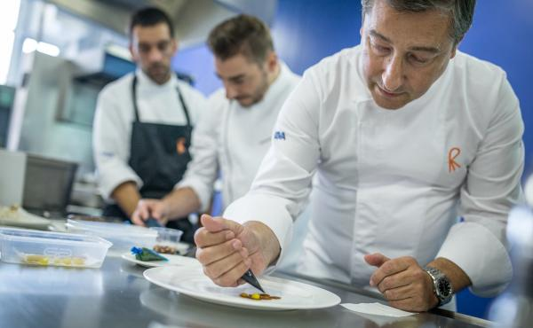 Joan Roca (foreground), head chef at El Celler de Can Roca, a top-rated restaurant in northeast Spain. Here Roca conducts a cooking demonstration at Westminster Kingsway College, in London.