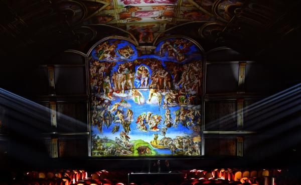 Technicians attend a rehearsal of the show Universal Judgment: Michelangelo and the Secrets of the Sistine Chapel, directed by Marco Balich, on March 13 near the Vatican. The Vatican Museums, which house the Sistine Chapel, provided high-definition digita