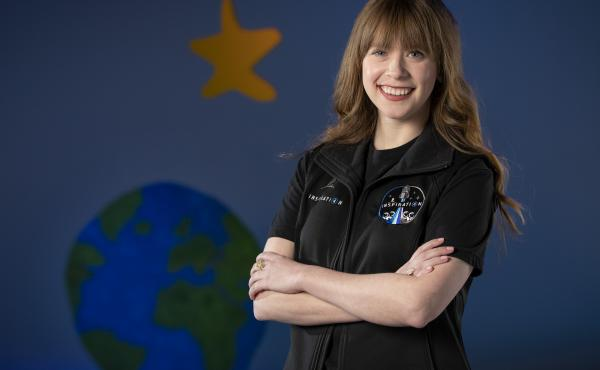 A photo provided by St. Jude Children's Research Hospital shows Hayley Arceneaux at the hospital in Memphis, Tenn. It announced on Monday that Arceneaux, a former patient and current employee, will be one of four crew members on the first all-civilian spa