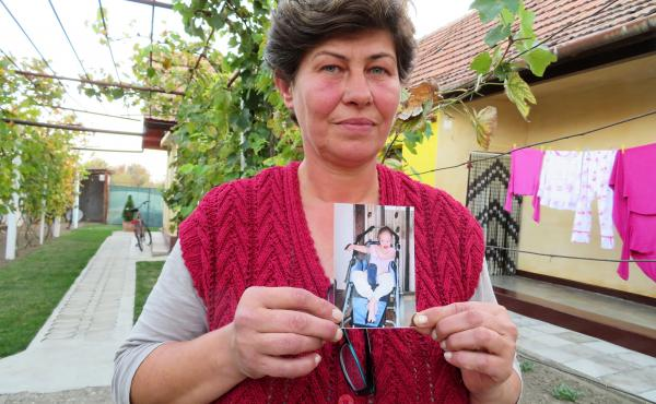 Liliana Czegledi holds a photo of her daughter, Ioana, at her home in the village of Sînandrei in western Romania. Ioana was just shy of her 10th birthday when she died of complications from measles. She could not be vaccinated because she had a compromi