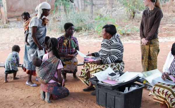 At a program aimed at preventing malnutrition in rural Malawi, nurse Lydia Kamenya counsels a young mother about a proper diet for children.