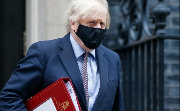 A mask-clad U.K. Prime Minister Boris Johnson departs from No. 10 Downing St. in London in March.