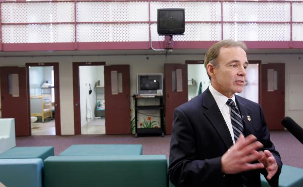 Garry Mead, assistant director of detention and removal for Immigration and Customs Enforcement, answers a reporter's question in 2007 in front of cells that housed immigrant families at the T. Don Hutto Residential Center in Taylor, Texas. After a suit b