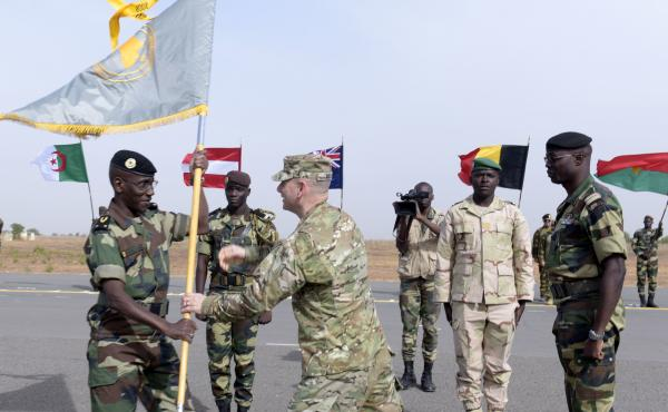 Senegalese Army Gen. Amadou Kane (left) receives the 2016 Flintlock flag from U.S. Army Gen. Donald Bolduc during the inauguration of a military base in Thiès, Senegal, in February 2016, during a three-week joint military exercise between African, U.S. a