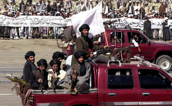 Members of the Taliban militia ride in vehicles during Afghanistan's annual Independence Day parade in Kabul on Aug. 19, 2001. Afghanistan was largely cut off from the world during the Taliban's rule from 1996 to 2001. That changed dramatically after the