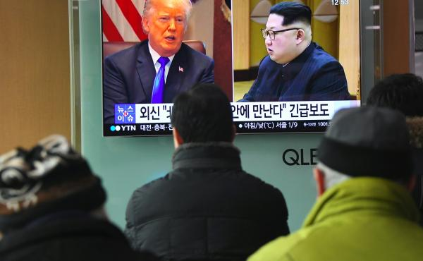 South Koreans at a railway station in Seoul watch a news report showing President Trump and North Korean leader Kim Jong Un on March 9. Trump agreed the day before to a historic first meeting with Kim.