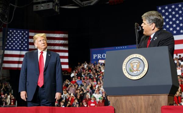 President Trump listens as Fox News host Sean Hannity speaks during a rally Nov. 5, 2018, in Cape Girardeau, Mo.