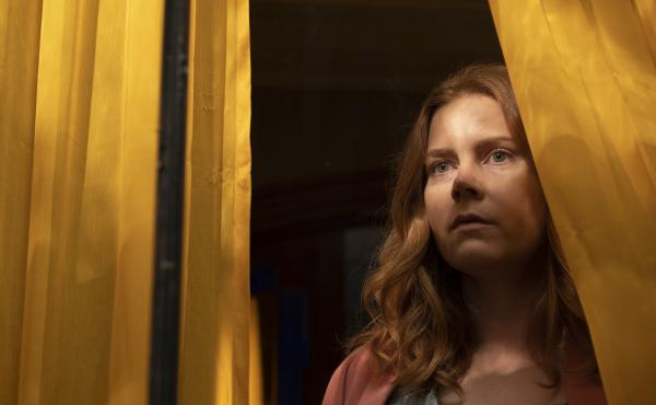 Amy Adams stars as Anna Fox in the Netflix film The Woman In The Window.