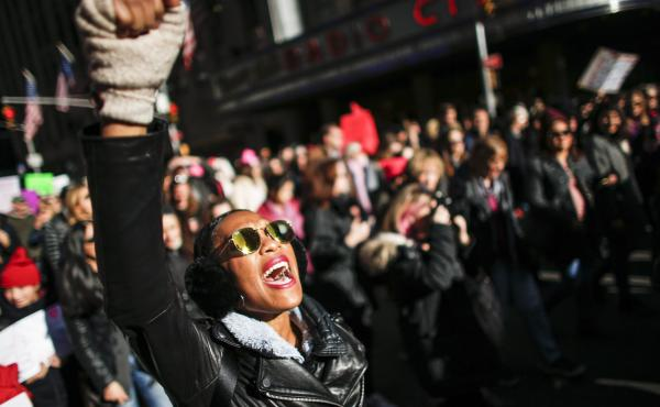 A woman shouts slogans during the Women's March in New York City, January 20, 2018, as protestors took to the streets en masse across the United States. It was a sign of lasting outrage, coming a year after the first women's marches following President Tr