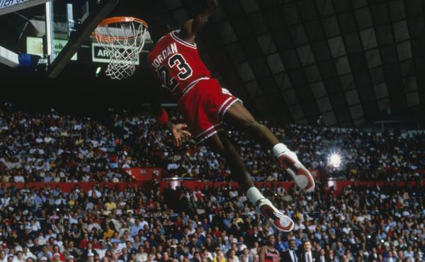 UNDATED: Chicago Bulls' forward Michael Jordan #23 dunks as the crowd takes photos during a game against the Portland Trail Blazers circa 1984-1998. (Photo by Focus on Sport via Getty Images)