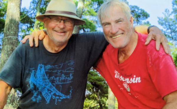 """Greg Klatkiewicz and Gary """"Zooks"""" Bezucha seen on one of their regular camping trips in 2019."""