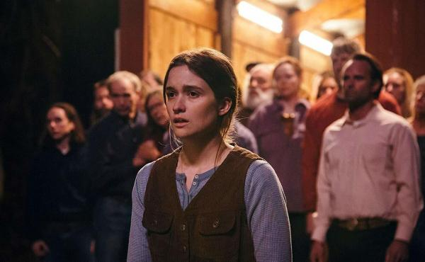 Alice Englert (center), Walton Goggins, and Olivia Colman star in this venomous tale of a snake-handling church community deep in the Appalachian mountains.