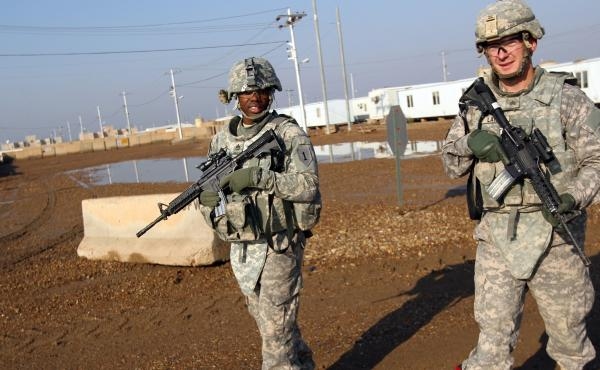 U.S. soldiers patrol the Taji base complex, which hosts Iraqi and U.S. troops north of the capital Baghdad. Taji is one of an eventual five sites where the U.S. and allied countries aim to train 5,000 Iraqi military personnel every six to eight weeks for