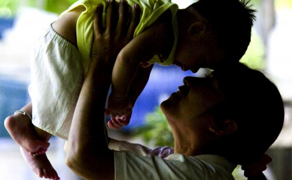 An HIV-positive mother in Thailand plays with her son, who did not contract the virus in utero. Thailand has eliminated mother-to-child transmission of HIV, according to the World Health Organization.
