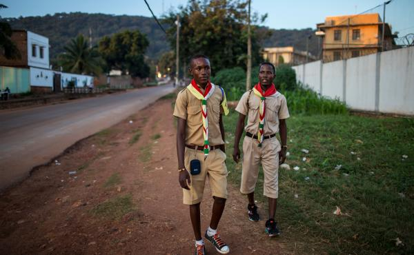 Members of Flambeaux — the evangelical Protestant scouting group — walk along a street in downtown Bangui, Central African Republic.
