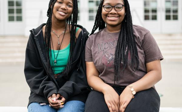 """Makiyah Hicks and Jonetta Harrison in front of their high school, Duke Ellington School of the Arts, in Washington, D.C. They are finalists in this year's NPR Student Podcast Challenge for their entry """"Loss and Transformation."""""""