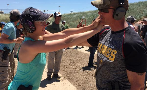 Kelly Blake, agricultural education teacher at Fleming School, learns how to protect herself from an attack with the help of local police officer Graham Dunne.