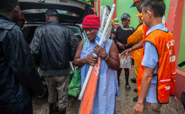 Haitians receive umbrellas as part of humanitarian aid after a 7.2 magnitude earthquake struck Haiti on Aug. 14.
