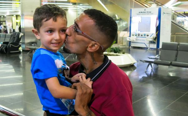 Naser al-Shimary, deported this year to Iraq from the U.S., greets his four-year-old son Vincent at Baghdad international airport. Shimary had lived in the U.S. since he was five years old. He agreed to be deported under a practice halted by a U.S. court