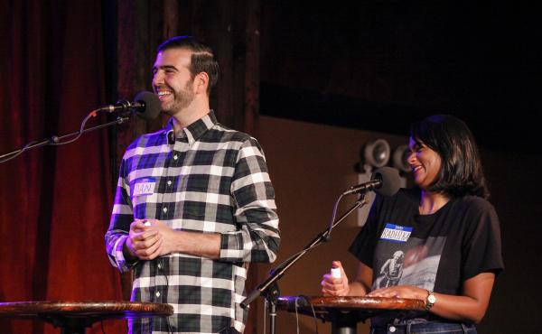 Contestants Dan Fleishaker and Radhika Nataraj face off in a game on Ask Me Another at the Bell House in Brooklyn, New York.