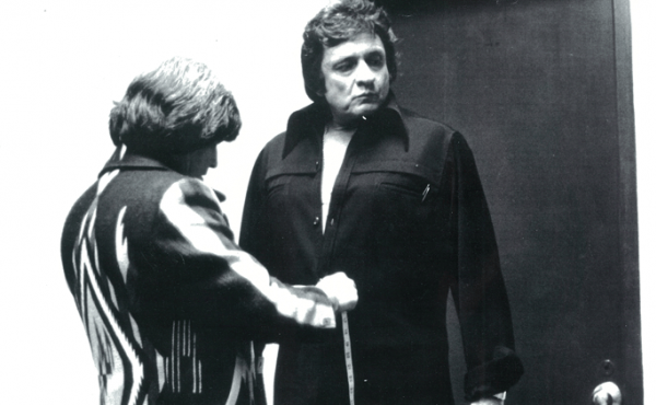 "Manuel Cuevas, left, is known for turning Johnny Cash, right, into ""the man in black."""