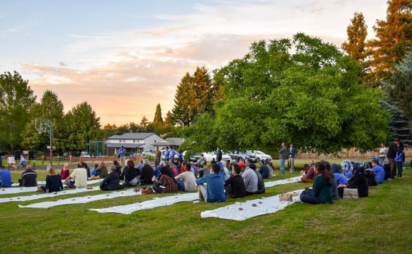 Open Iftar events are held outdoors (weather permitting), and are open to all. Often there are guest speakers and evening prayers, and then everyone —Muslim and non-Muslim alike —breaks bread together. Above, attendees at the first U.S. Open Iftar, he