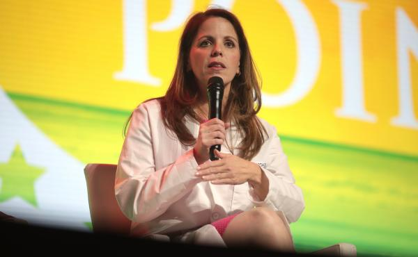 Dr. Simone Gold discourages vaccination against COVID-19 and promotes alternative, unproven therapies. She has spent much of the past year speaking at events like this one held in West Palm Beach, Fla., in December. The conference was aimed at young peopl