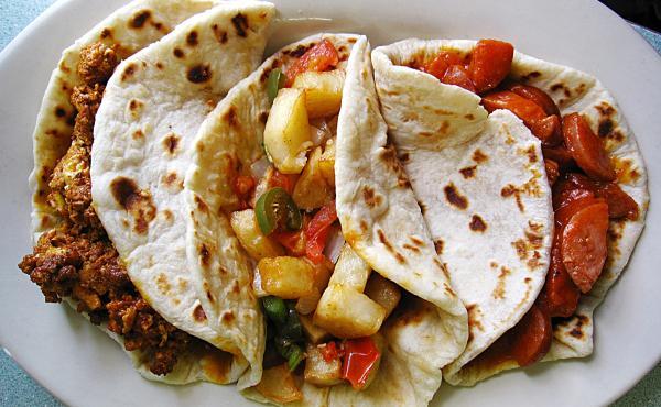 Chorizo and egg, papas rancheras and country guisado tacos on handmade flour tortillas from Mendez Cafe in San Antonio.