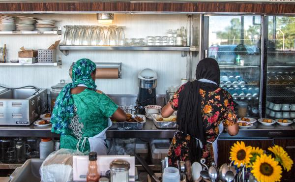 Minara Begum (left) and her sister, Rajna Begum, served coconut Mishti (sweets) at the first Bandhu Gardens pop-up at Rose's Fine Food last July.
