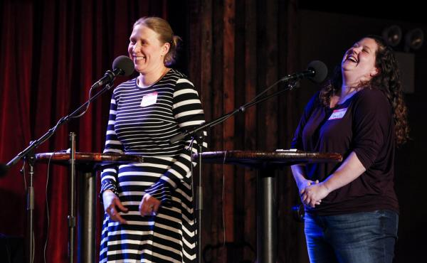 Contestants Britter Gunderson and Gayle Gawlik play a game on NPR's Ask Me Another at The Bell House in Brooklyn, New York.