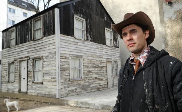 U.S. artist Ryan Mendoza poses for a photo next to the former house of Afro-American human rights figure Rosa Parks on Mendoza's property on April 6, 2017 in Berlin, Germany. Mendoza bought the house, which was slated for demolition in Detroit, took it ap