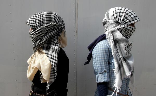 """Black-and white-keffiyeh like the one pictured above, have been long associated with Yasser Arafat and the Palestinian resistance. This week, fast-fashion Brit emporium Top Shop, used similar fabric for a """"scarf playsuit."""""""