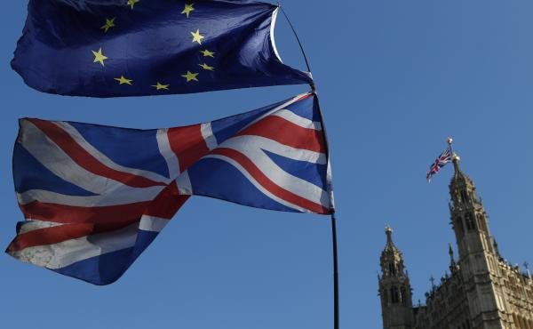 Flags of the European Union and Great Britain are flown during a demonstration in London on Feb. 27. A key vote is to take place in Parliament on Tuesday.