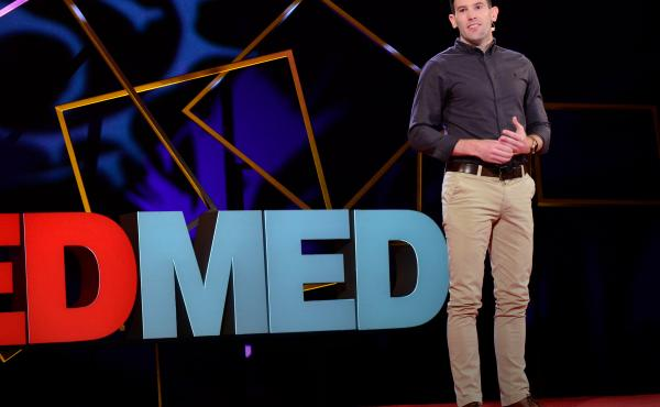 Thomas Curran on the TED Stage.