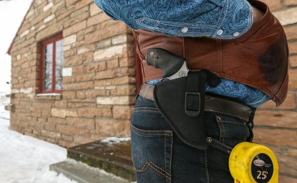 The armed individuals occupying part of the Malheur National Wildlife Refuge in Oregon include Ryan Bundy. On Thursday, he had a gun and a tape measure on his side. Bundy is the son of Cliven Bundy, whose 2014 armed standoff with the federal Bureau of Lan
